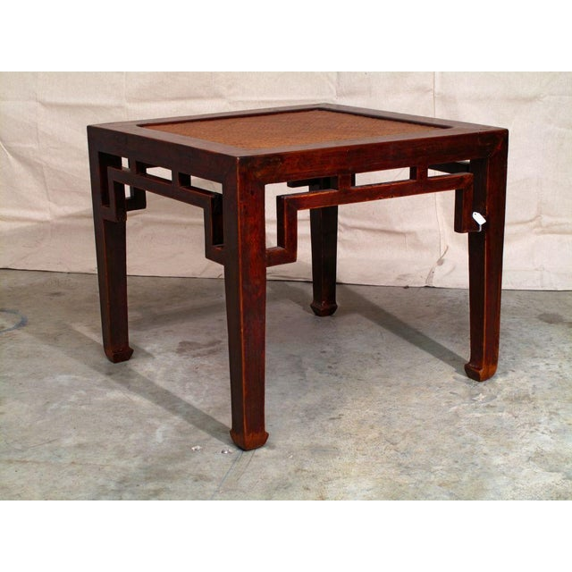 A well constructed Chinese square side table of elm wood. Clean and simple lines, with minimal decoration. The apron, with...