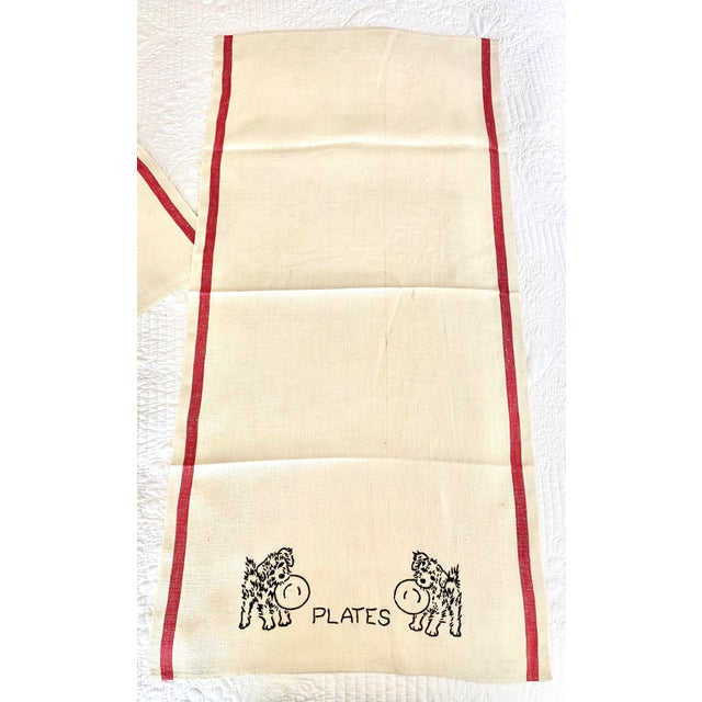 Adorable linen dish towels hand embroidered with dogs (terriers) resembling FDR's Scottie, Fala. Each towel depicts a...
