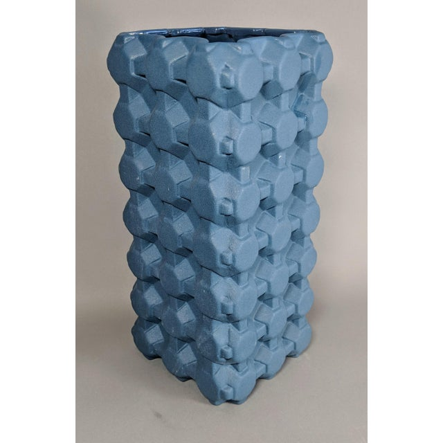 This geometric, gird vase from Thom Dixon is inspired from the looks of everyday patterns such as egg cartons. A perfect...