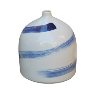 White Vase With Blue Brushstrokes Spinning For Sale