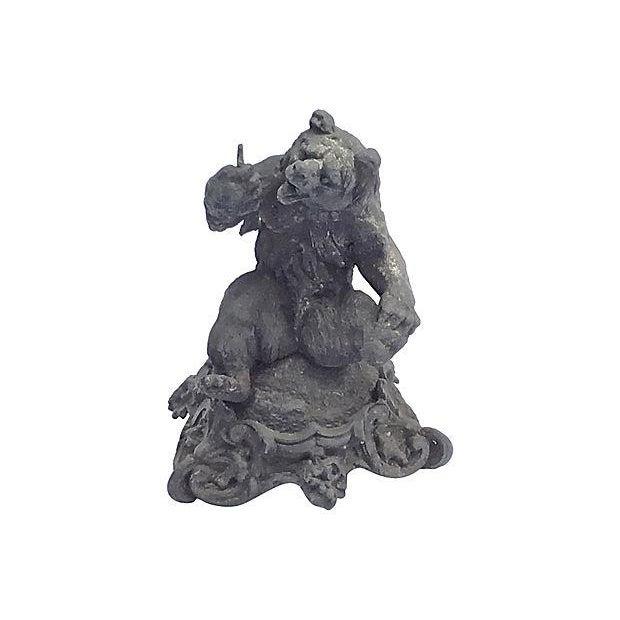 Antique; 19th century, English, cast iron, bear figurine sitting on a stylized acanthus leaf base. No maker's mark....