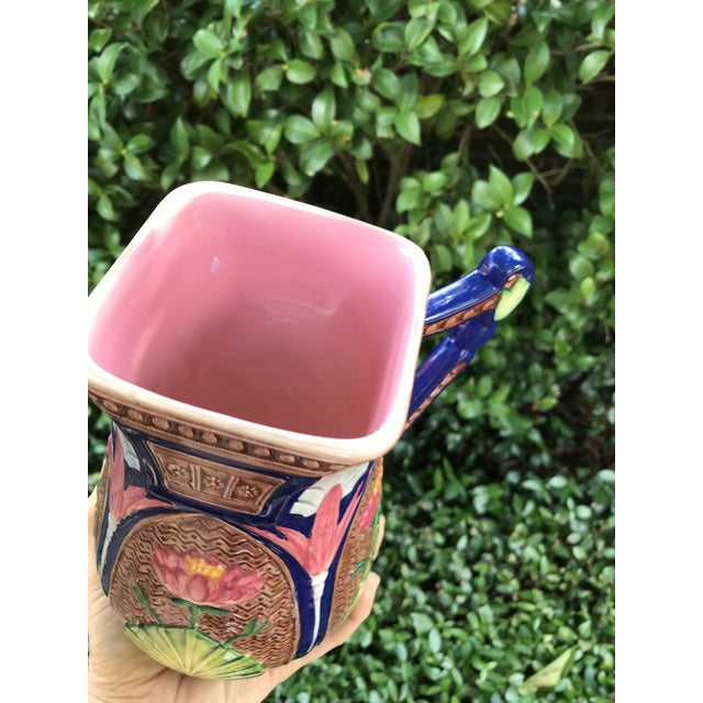Majolica pitcher. The colors are AMAZING on this one. Painted for Seymour Mann. It measures 8 inches tall. In excellent...