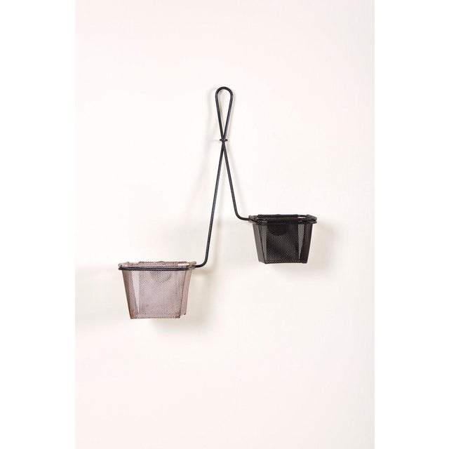 """Wall hanging planter holder """"Chambord"""" designed by Mathieu Matégot, circa 1950. Manufactured in France by Ateliers..."""