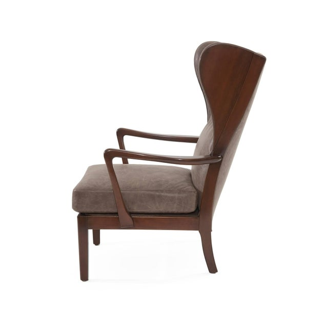 Remarkable Scandinavian wingback lounge chair, circa late 1950s. This example has a newly finished solid maple frame and...