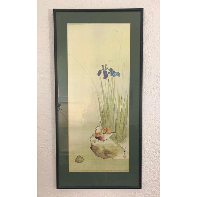 Elegant Japanese print with water fowl and irises and Japanese writing in the lower right corner. Delicate watercolor...