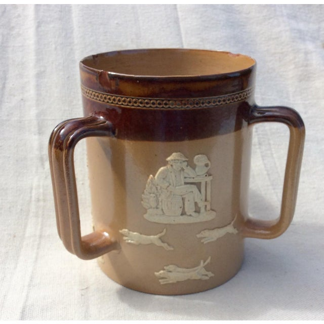 Large Royal Doulton Lambeth Stoneware Tankard. Salt glazed finish with farming scenes circa 1900. Note as is condition...