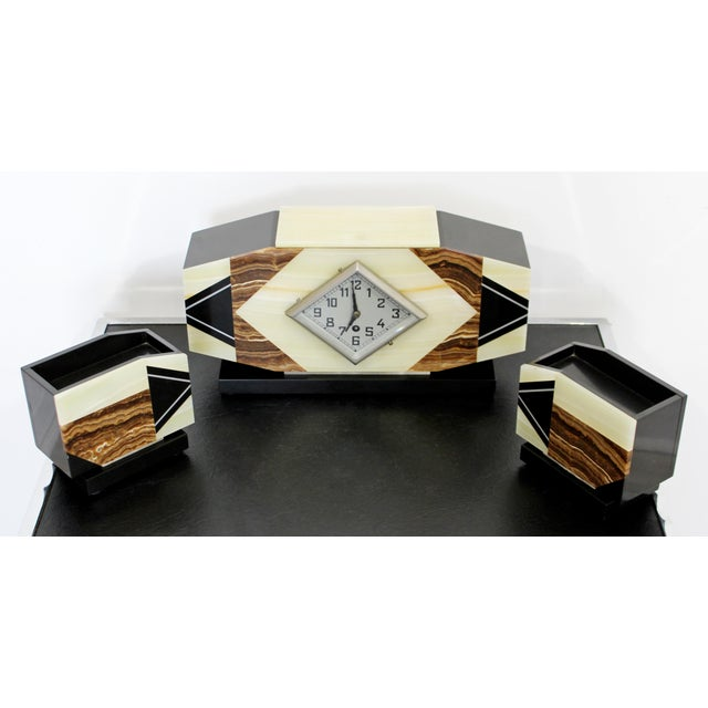 For your consideration is a magnificent, marble and onyx mantle clock, with a matching pair of bookends, circa the early...