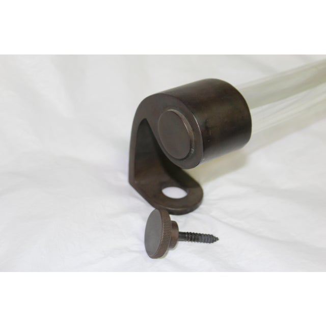 Great look.A large handle with Solid bronze cast mounting hardware with screw knobs. Made for a Hotel entry door,s in New...