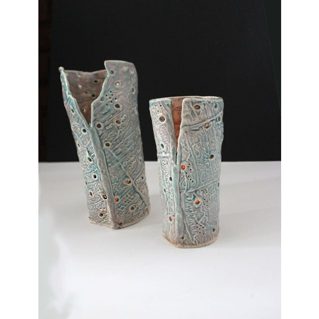 Two ceramic slab pastel candle hurricanes. Handmade with a futuristic pattern signed by artist Troy from 2013.