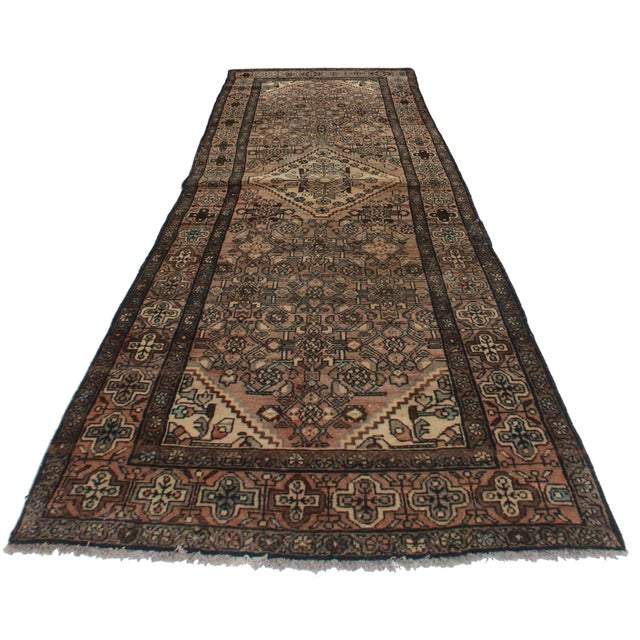 Here is a vintage Persian Malayer runner rug. Hand-knotted from wool. Features a lovely geometric design and rich, bold...