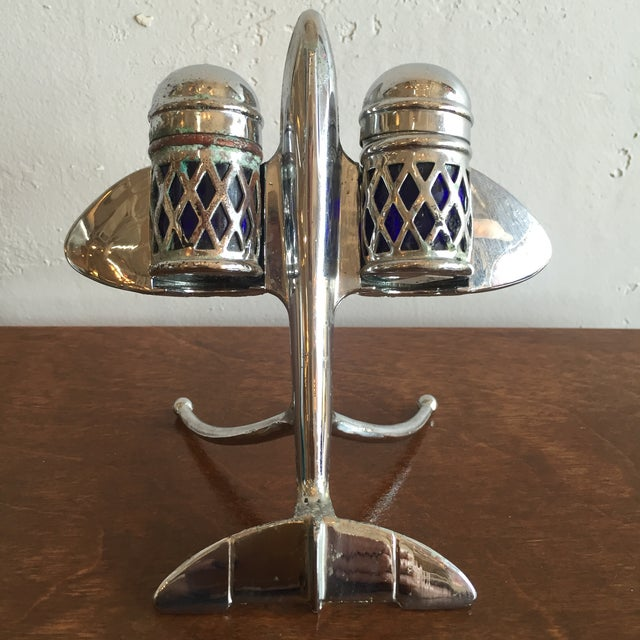 Collectable and rare salt & pepper set in chrome and cobalt blue glass with chrome airplane stand. Circa 1920's. Makers...