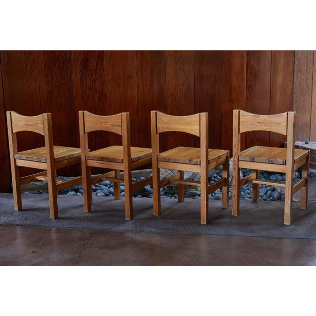 Set of four 1960s Ilmari Tapiovaara dining chairs for Laukaan Puu Oy, Finland. Executed in solid pine. Designed in 1963,...