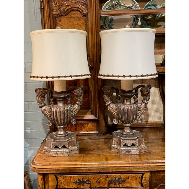"""A pair of antique silver gilt candle picks converted to lamps. 10"""" Wide x 8"""" Deep x 25"""" High Shade 11"""" diameter x 9"""" High"""