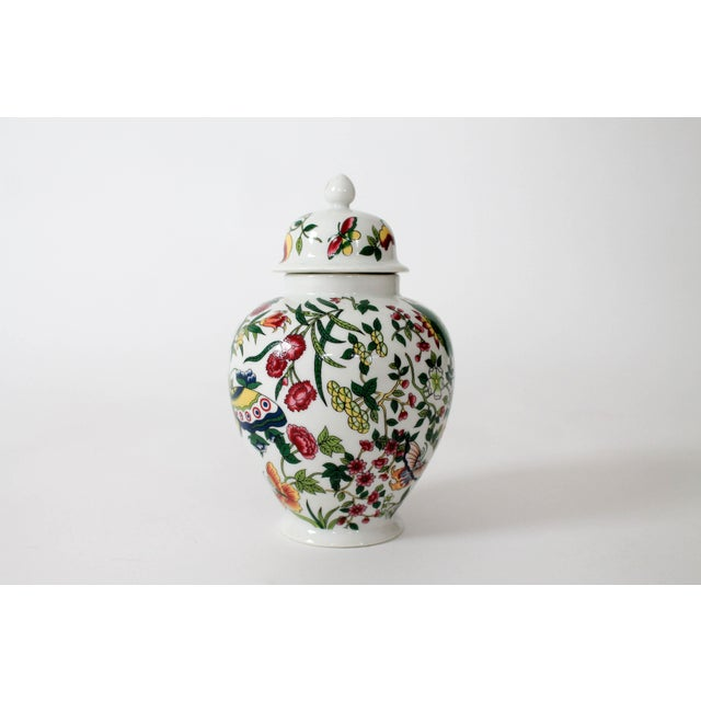 """Vibrantly colored ceramic ginger jar with butterflies and flowering motif. Marked """"Thousand Butterflies"""" by Eda Mann. Made..."""