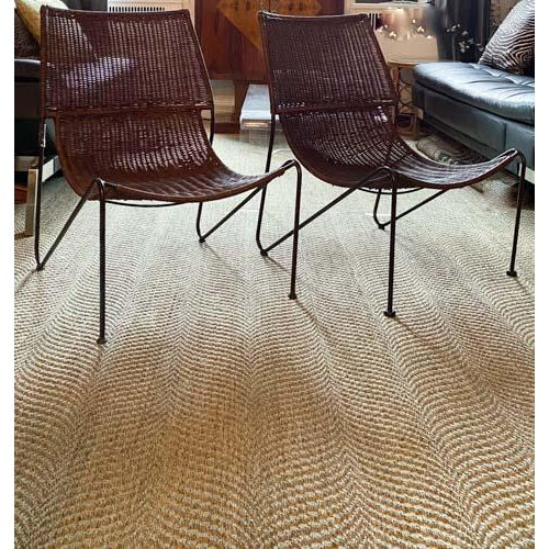 Pair of stylish lounge chairs in woven rattan and steel in the manner of Frederick Weinberg and Van Keppel Green. Believed...