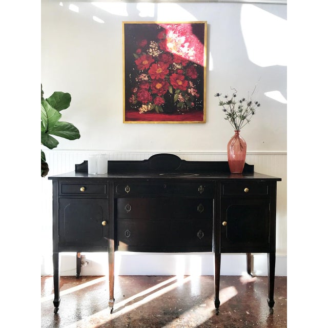 'Viola' Black Sideboard Circa: 1920s/1930s Condition: Great with natural wear from age This antique solid wood sideboard...