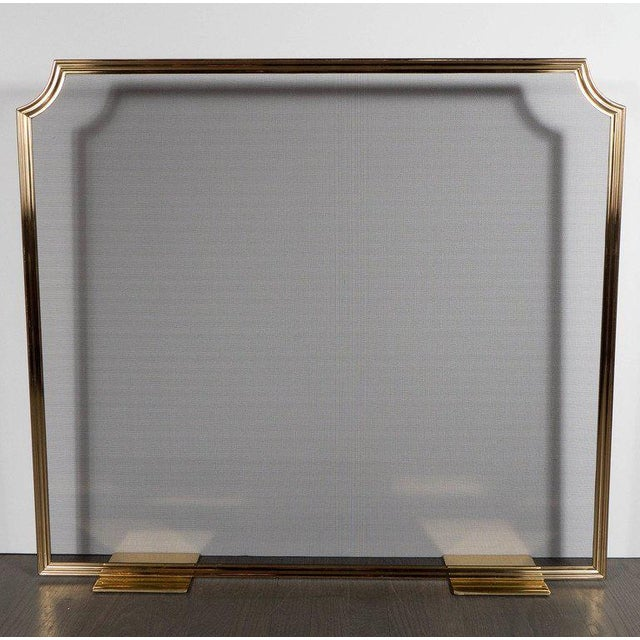 This custom-made fire screen features a lightweight design with a slimline polished brass frame and mesh with truncated...