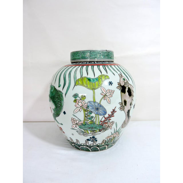 Chinoiserie 'Kangxi' Chinese Pink & White Lotus Flower Porcelain Ginger Jar With Green and Blue Fish For Sale - Image 3 of 10