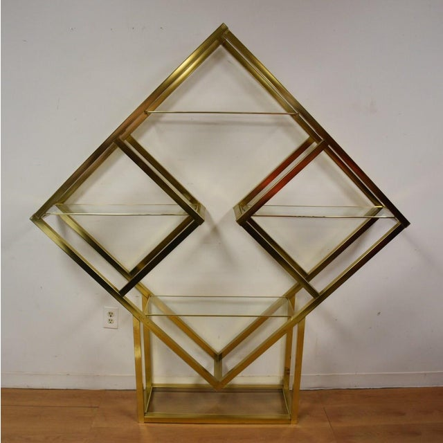 Hollywood Regency style brass etagere display shelving with 5 shelves in a diamond formation. Missing one cap as shown.