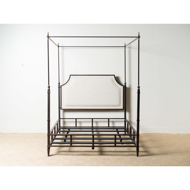 Iron framed bed Neutral linen upholstery May be used with or without teester