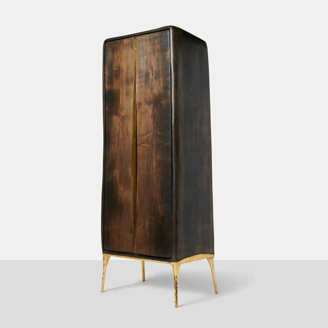 Valentin Loellmann, Armoire An organic shaped two door armoire in walnut with brass lined doors and door pulls. The...