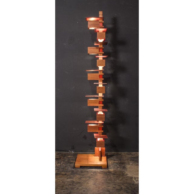 This is a reproduction floor lamp from the design of Frank Lloyd Wright. It is done to the exact traditional method of...