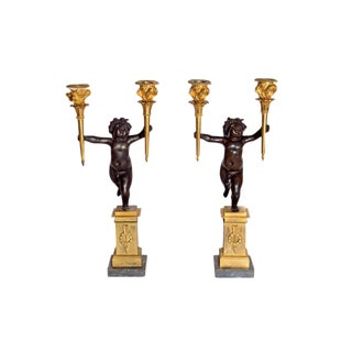 Pair of French Charles X Patinated Bronze and Gilt Figurative Candelabras For Sale