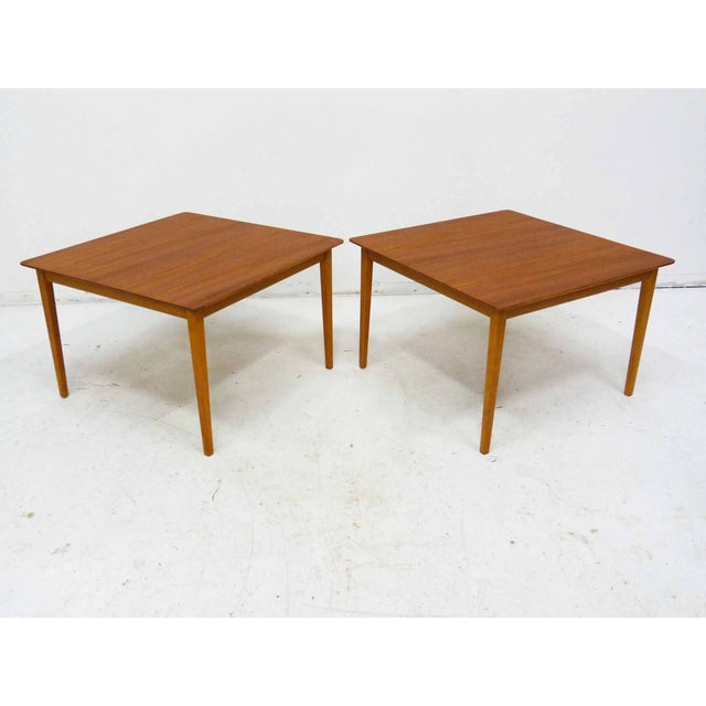 Offered is a pair of mid century Swedish teak side tables by Tingstroms. Stamped: Made in Sweden and labeled. Light wear...