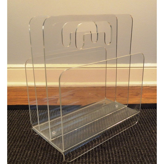 Very cool mid-century acrylic magazine rack with handle. An easy way to add a modern touch to any room. In very good...