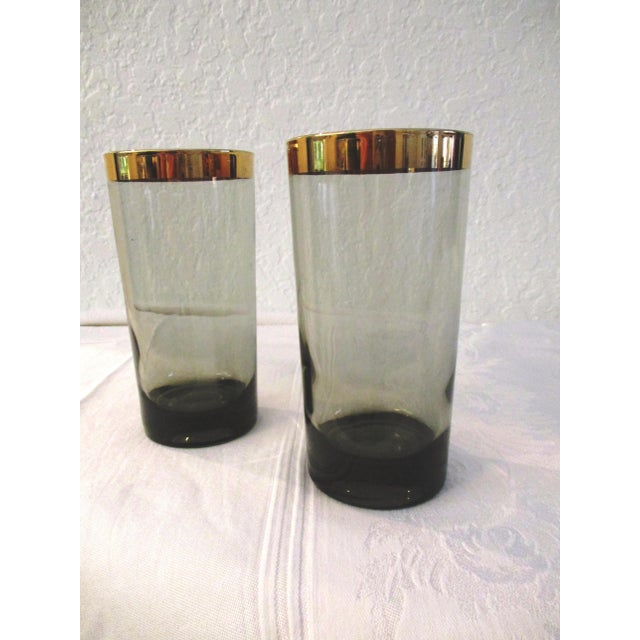 Sophisticated set of seven 1970s gold-banded black smoke highball glasses with thick bases. Minor wear.