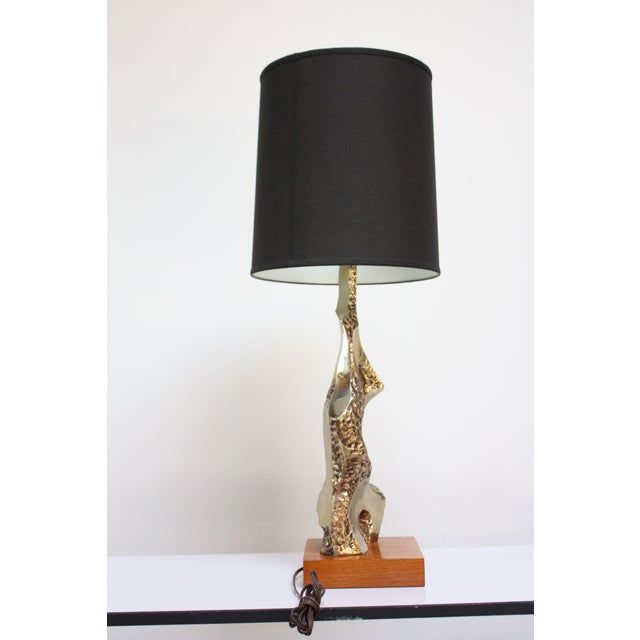 Brutalist Tempestini table lamp composed of a hammered and polished brass frame on walnut base. Nice, contrasting textures...