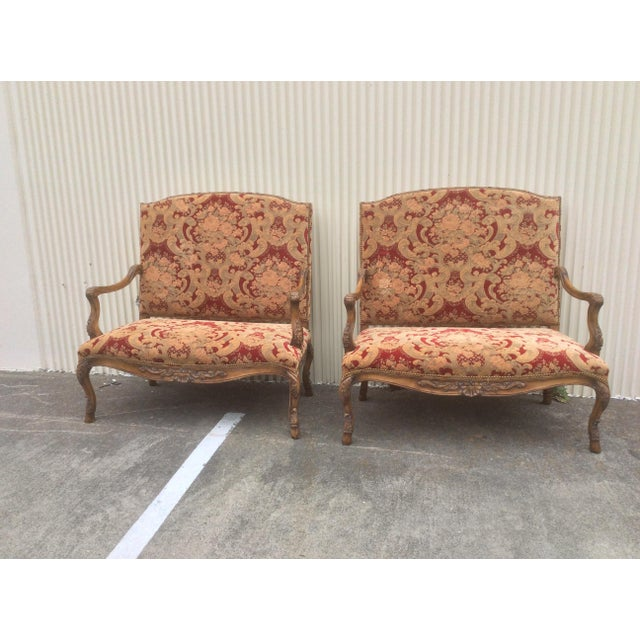 Great looking pair of late 20th Century European style marquis benches or settees with classic upholstery.