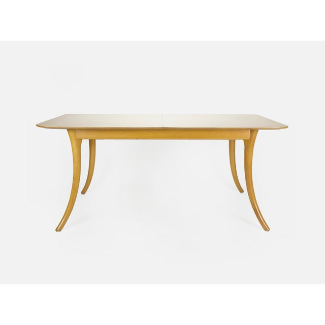 Striking Mid Century modern extending dining table designed by T.H. Robsjohn-Gibbings for Widdicomb. The table features a...