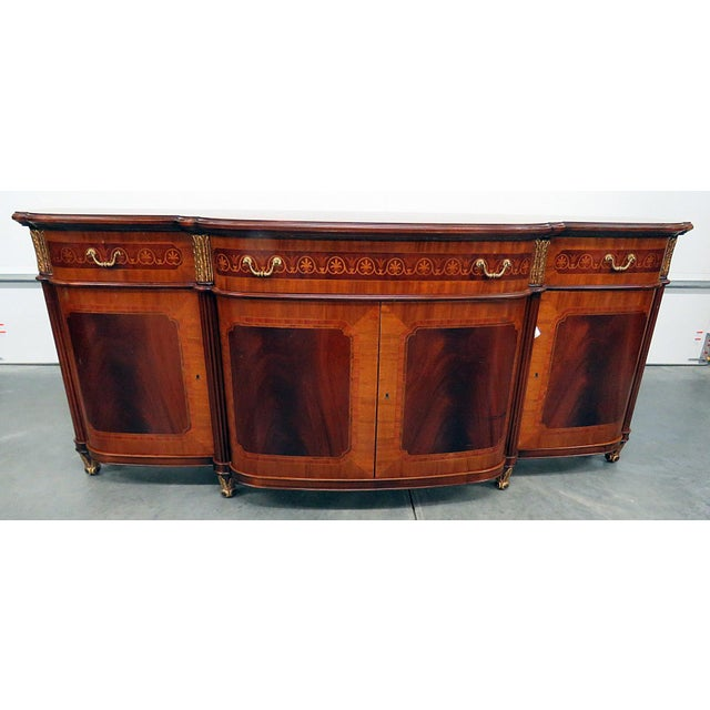 Decorative Crafts, Inc Regency style inlaid sideboard with gilt accents and 3 drawers over 4 doors.