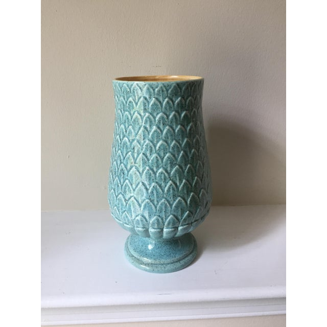 Great color inside and out on this sweet footed vase in a leaf motif by American maker Red Wing. Textured aqua outside...