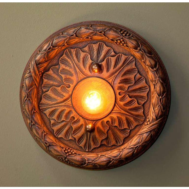 Belgian wooden flush mount light (circa 1930) crafted from a beautifully hand-carved ceiling medallion. Newly wired for...