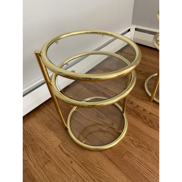 """These mid-century brass and glass cocktail tables with tops that swivel scream """"swanky."""""""
