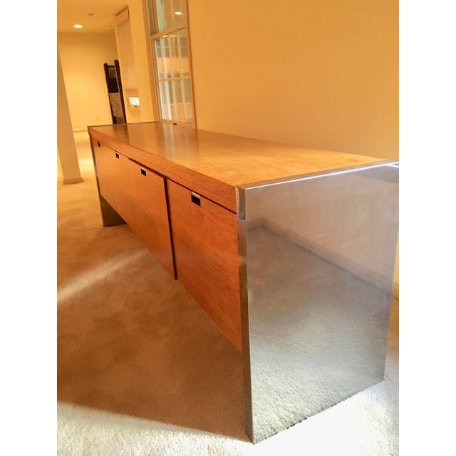 An outstanding Mid-Century chrome and mahogany credenza designed for Dunbar's executive collection. The credenza features...