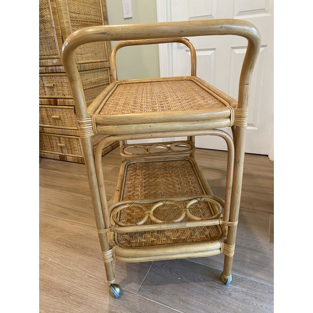 Beautiful 1970s original rattan bent bamboo bar cart. This is truly a gorgeous piece and perfect for entertaining guest....
