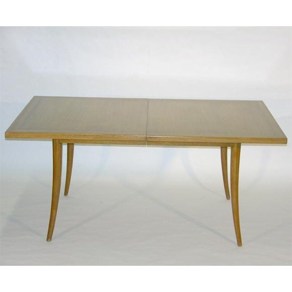 A classic sabre leg dining table with a three inch inlayed border to the table surface. It is comprised of two removable...