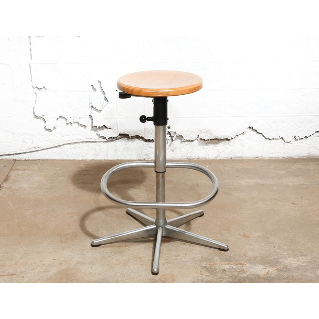 """Blonde wood top on hydraulic swivel base with footrest. The Netherlands 1979 Adjustable height. Size: 25""""H x 28""""W x 28""""D..."""