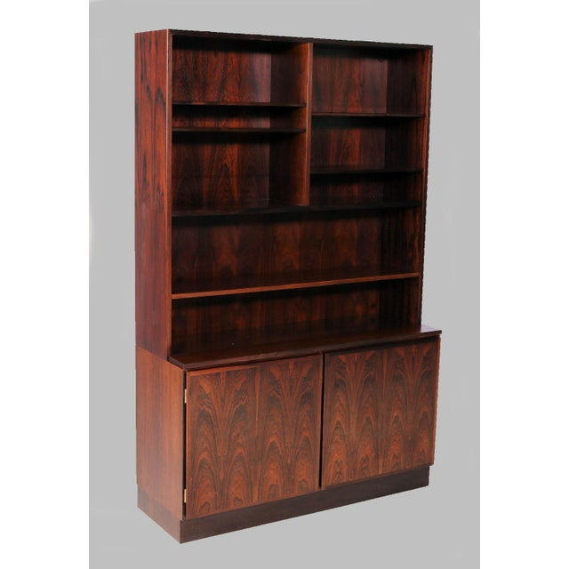 1960s-1970s rosewood shelf unit and cabinet designed by Gunni Omann for Omann Jun. The unit can be split into a cabinet...