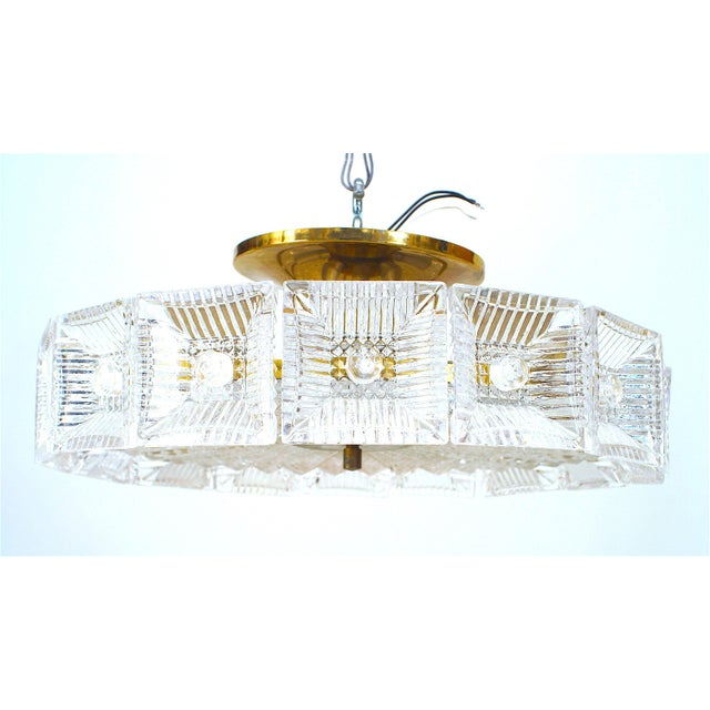 Swedish (Orrefors) Mid-20th Century chandelier with square concave glass panels in a circle over a textured round bottom...