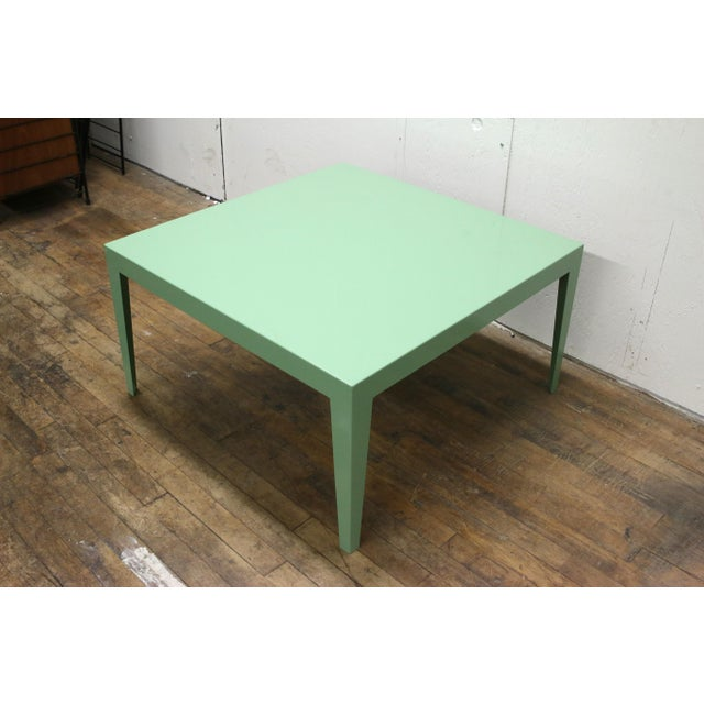An elegant and minimal square table estimated to date to the 1950s. The table is made of powder coated steel and is in...