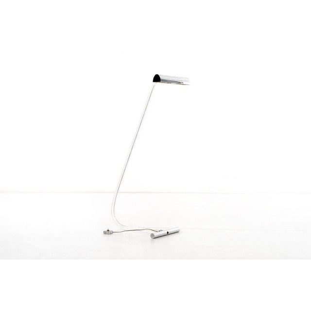 A floor lamp by designer Peter Hamburger, produced, circa 1970s for the Crylicord series from Knoll, with curved stem in...