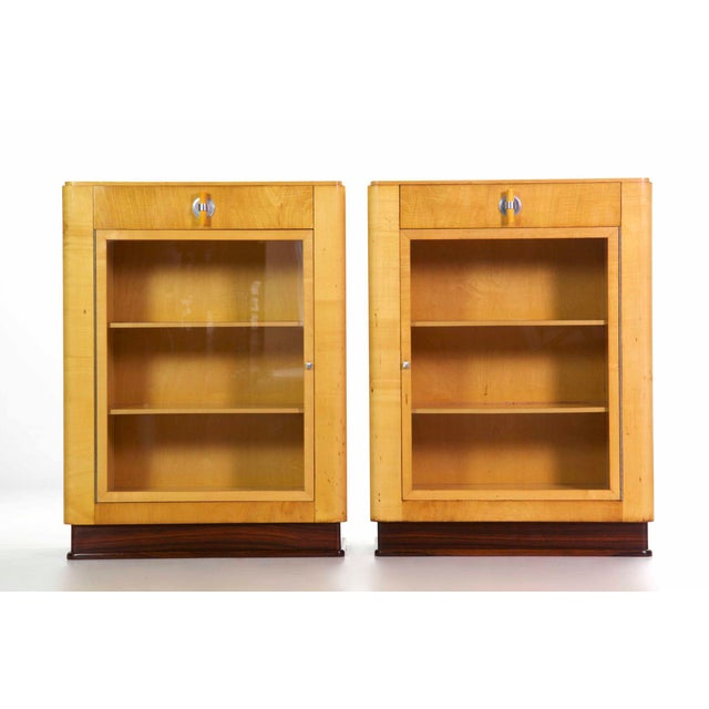 PAIR OF ART DECO BIRCH, ROSEWOOD AND STEEL BOOKCASES Streamline Modern movement, circa 1930s; of superb quality throughout...
