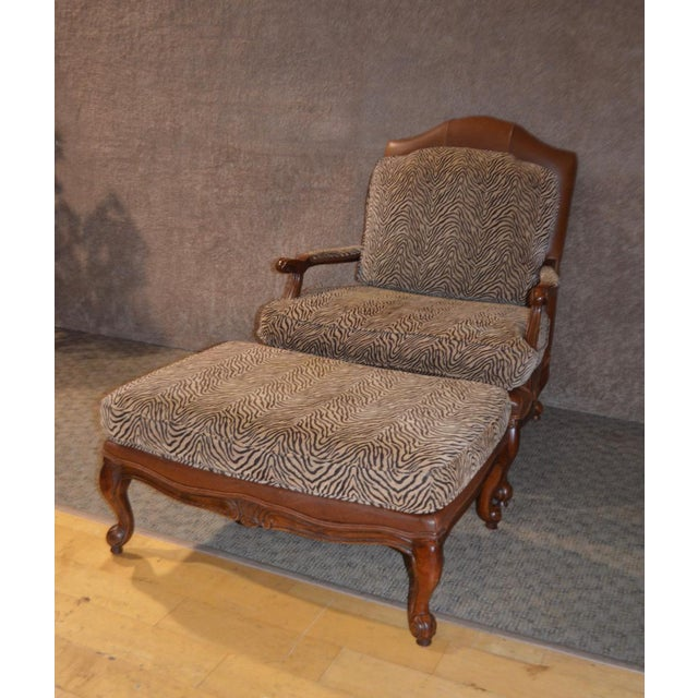 Designer Style Oversized Chair & Ottoman made by Ethan Allen. This chair has a camel colored leather and a tan & brown...