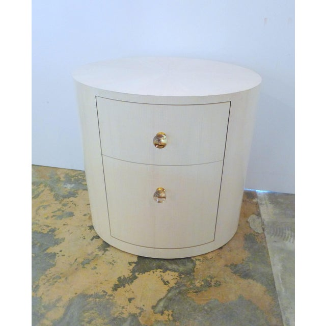 Paul Marra Italian-Inspired 1970s style Oval Nightstand. Shown in bleached maple, starburst inlay, vintage crystal gold-...