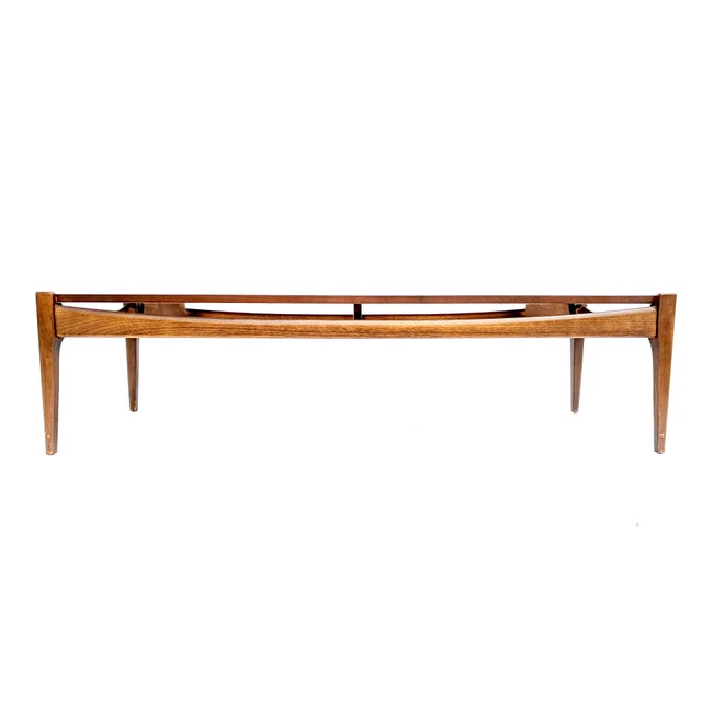 Mid-century modern walnut coffee table by Bassett Furniture Industries. Beautiful mid-century modern design, in very good...