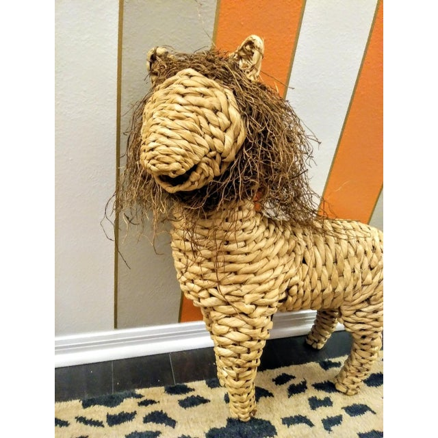 Sweet whimsical rattan lion decorative statue. This sweet little guy will add such a fun touch to any room. He has twigs...
